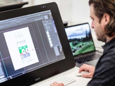 A designer working on product images for Zevo on a design software, a PGV partner.